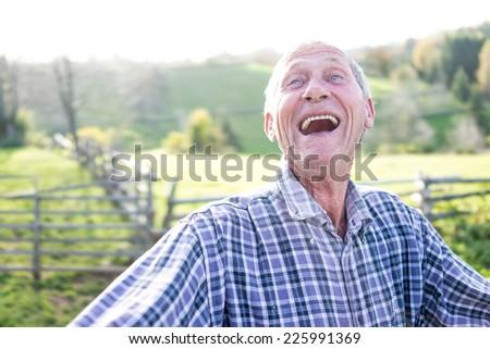 Smiling senior authentic man - stock photo