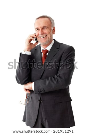 Smiling senior business man, phoning - stock photo