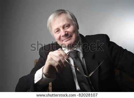 Smiling senior businessman - stock photo