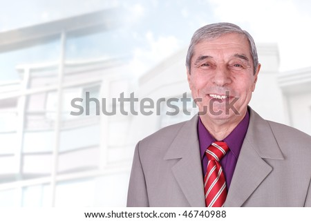 Smiling senior businessman in front of blur background - stock photo