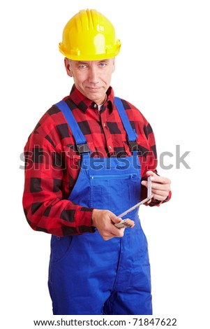 Smiling senior construction worker with folding rule - stock photo
