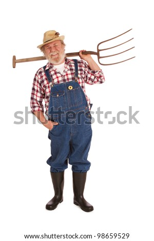 Smiling senior farmer with straw hat, plaid shirt, bib overalls, lifting pitchfork over one shoulder. Vertical layout, isolated on white background with copy space. - stock photo