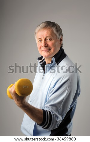Smiling senior fitness man with barbells - stock photo