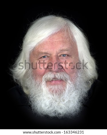 Smiling senior -  happy and healthy elderly man with full wild beard - stock photo