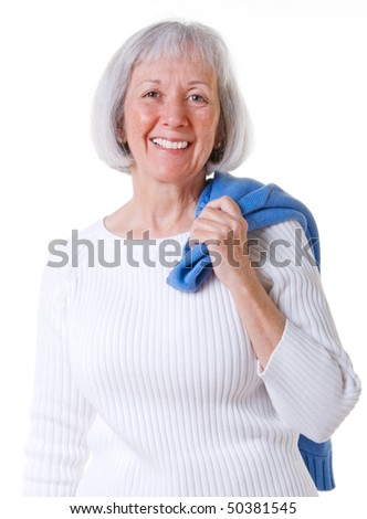 Smiling senior lady wearing a white sweater - stock photo