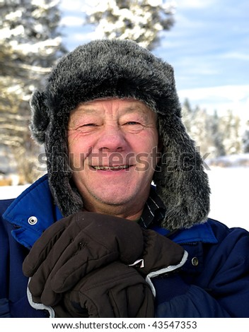 Smiling senior male with winter hat - stock photo