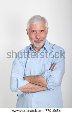 Smiling senior man with blue shirt - stock photo