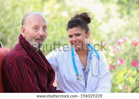 smiling senior patient with Doctor or nurse
