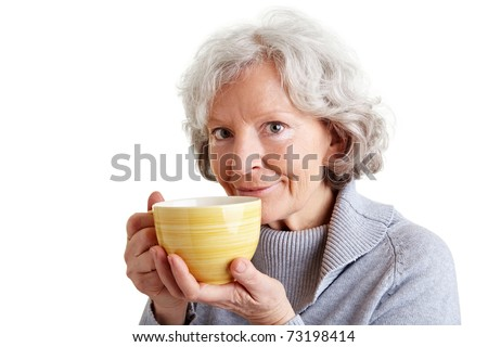 Smiling senior woman drinking a big cup of coffee - stock photo