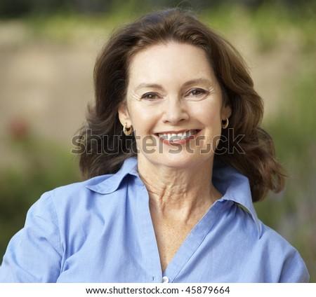 Smiling Senior Woman In Garden - stock photo