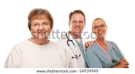 Smiling Senior Woman with Medical Doctor and Nurse Behind Isolated on a White Background.