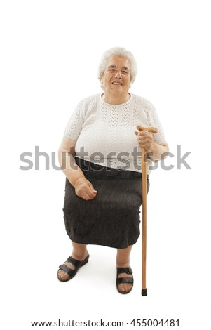 Smiling senior woman with walking stick, sitting. Isolated on white background  - stock photo