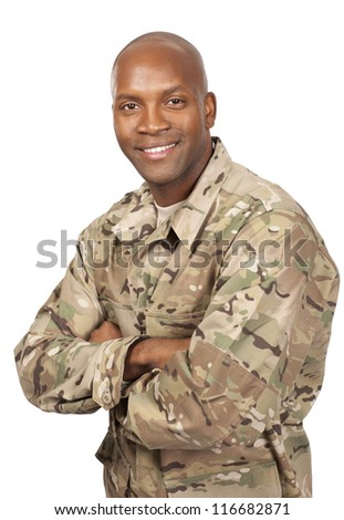 Smiling serviceman with his arms crossed - stock photo