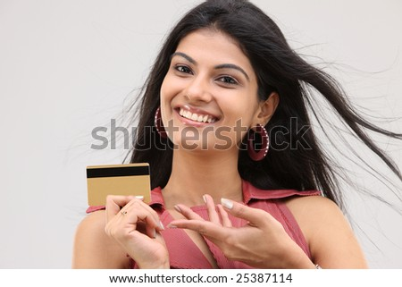 Smiling sexy girl with credit  card - stock photo