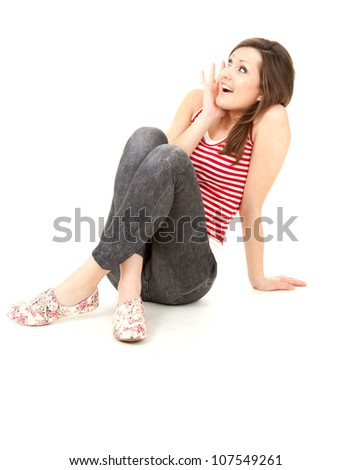 smiling shocked young woman looking up, full length, white background - stock photo