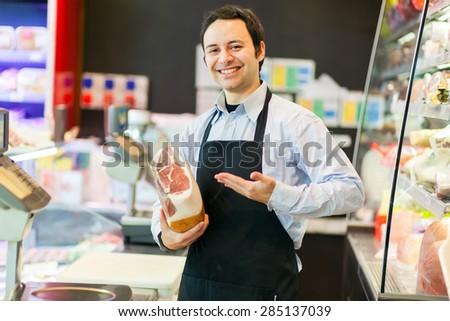 Smiling shopkeeper - stock photo
