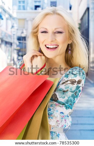 Smiling shopping girl with bags. - stock photo