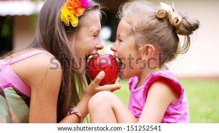 Smiling sisters - stock photo
