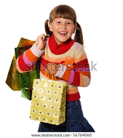 Smiling six years Girl holding presents bags isolated