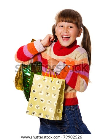 Smiling six years Girl holding presents bags isolated - stock photo