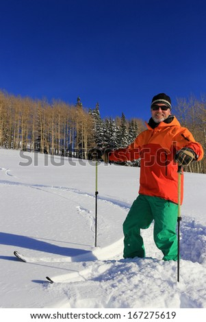 Smiling skier on a beautiful winter day, Utah, USA. - stock photo
