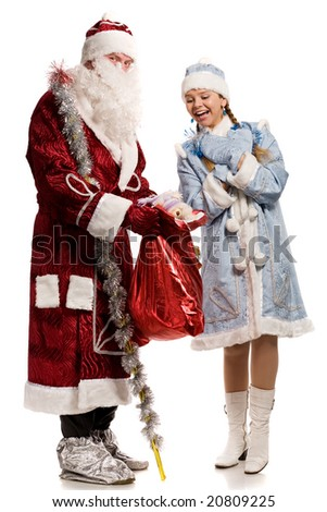 Smiling snow maiden and Santa Claus with gifts, isolated on white