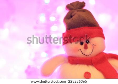 Smiling snowman against bokeh christmas lights - stock photo