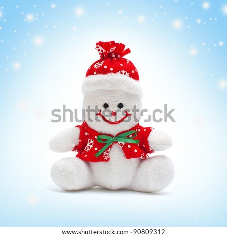 Smiling snowman toy dressed in scarf and cap