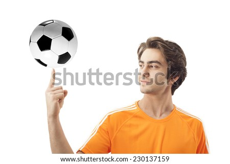 Smiling soccer holding a football on isolated