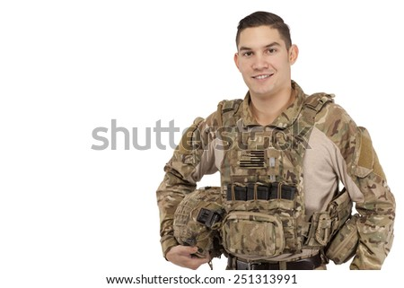 Smiling soldier in safety wear posing against white background - stock photo