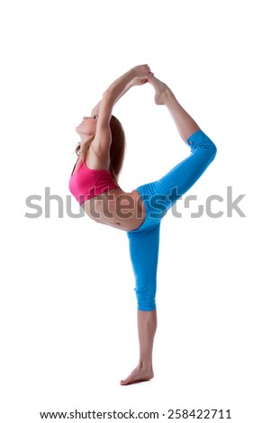 Smiling sportswoman doing difficult stretching - stock photo