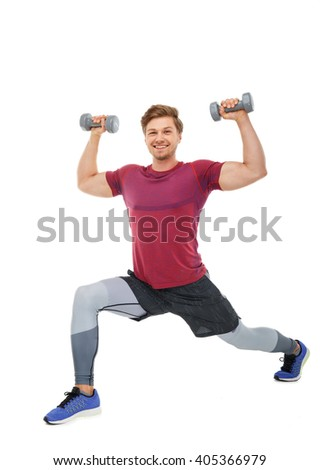 Smiling sporty man doing legs workouts with dumbbells. Isolated on a white background.