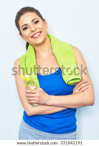 smiling sporty woman studio portrait with water bottle, towel. isolated portrait. toothy smiling female model. - stock photo