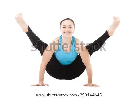 Smiling sporty yogi girl doing fitness exercises, yoga asana Tittibhasana, arm balance Firefly posture, Insect Pose, isolated on white background - stock photo