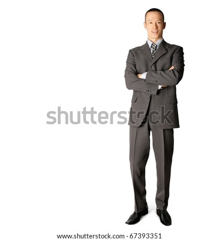 smiling standing businessman in suit isolated on white