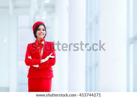Smiling stewardess at airport