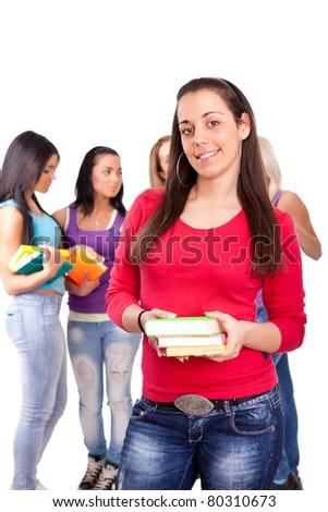 smiling student girl holding books  with group university students on the background- isolated - stock photo