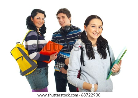 Smiling student girl holding notebook and her colleagues isolated on white background