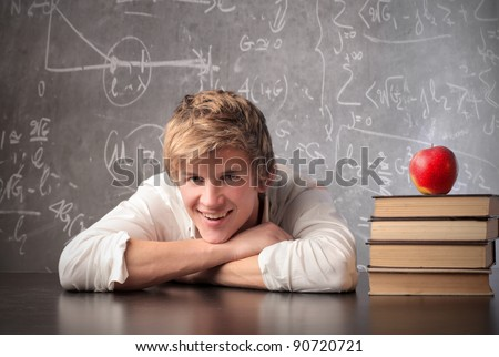 Smiling student in a classroom - stock photo