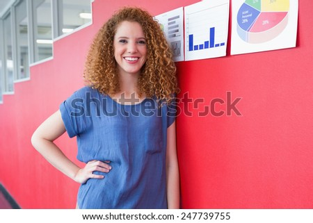 Smiling student standing and posing at the college - stock photo