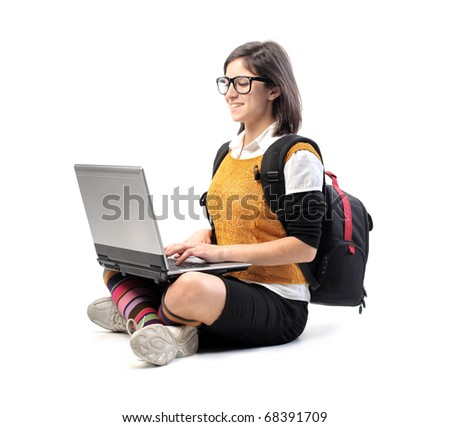 Smiling student using a laptop