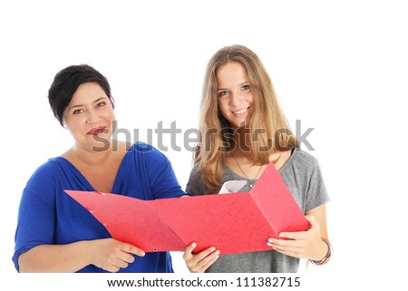 Smiling student with mother or teacher Smiling young female student holding a large red open folder standing with her mother or teacher discussing her assignement isolated on white - stock photo