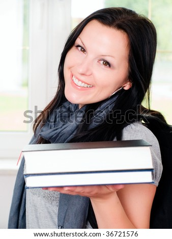 smiling student woman with backpack holding books