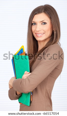 smiling student woman with colored note pad - stock photo