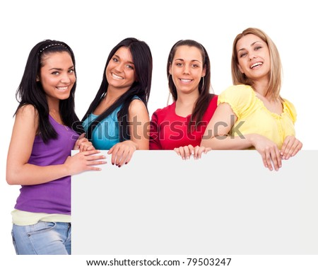 smiling students behind big blank billboard, teenagers girls, isolated on white background - stock photo