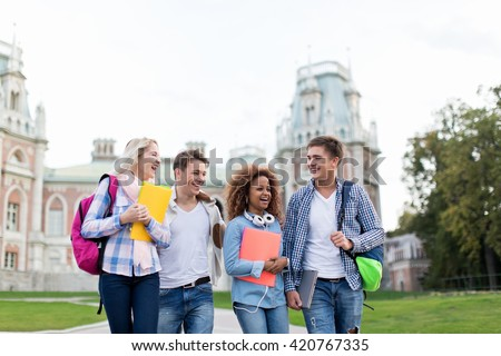 Smiling students in park - stock photo