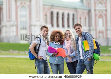 Smiling students on campus outdoors - stock photo
