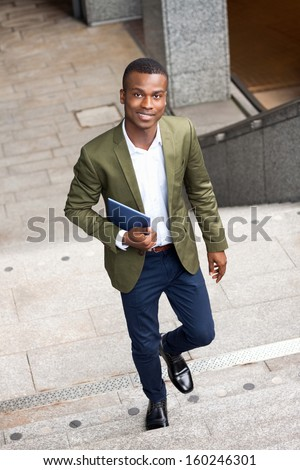 smiling successful businessman with tablet pc outdoor in summer  - stock photo