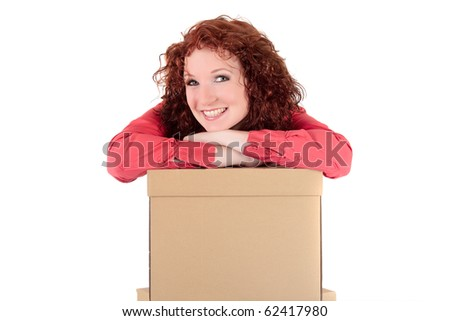 Smiling successful businesswoman behind a stack of storage boxes and leaning on. Studio shot. Half-length. White background