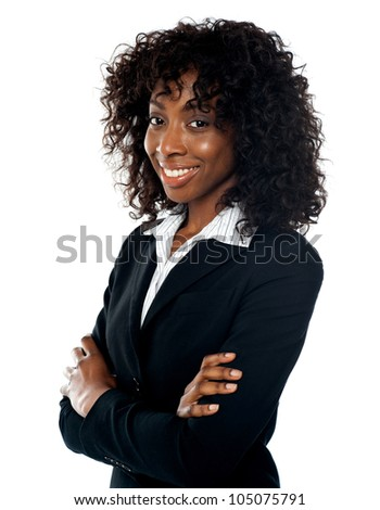 Smiling successful businesswoman posing with folded arms